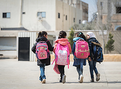 18 February 2020, Amman, Jordan: A group of girls leave for the day at the Rufaida Al Aslamieh Primary Mixed School in the Sahab district. The school serves more than 1,000 students from kindergarten up to 10th grade, most of them girls from Jordan but also some from Syria and other countries, and, in the lower grades, also boys.