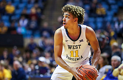 Dec 22, 2018; Morgantown, WV, USA; West Virginia Mountaineers forward Emmitt Matthews Jr. (11) looks to pass during the second half against the Jacksonville State Gamecocks at WVU Coliseum. Mandatory Credit: Ben Queen-USA TODAY Sports