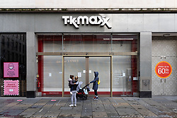 Glasgow, Scotland, UK. 21 November 2020. Views of Saturday afternoon in Glasgow city centre on first day of level 4 lockdown. Non essential shops and businesses have closed. And streets are very quiet. Pictured; TK Maxx store is shuttered and closed   .Iain Masterton/Alamy Live News