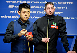 Liang Wenbo studies the table in his match against Stuart Carrington on day four of the Betfred Snooker World Championships at the Crucible Theatre, Sheffield.