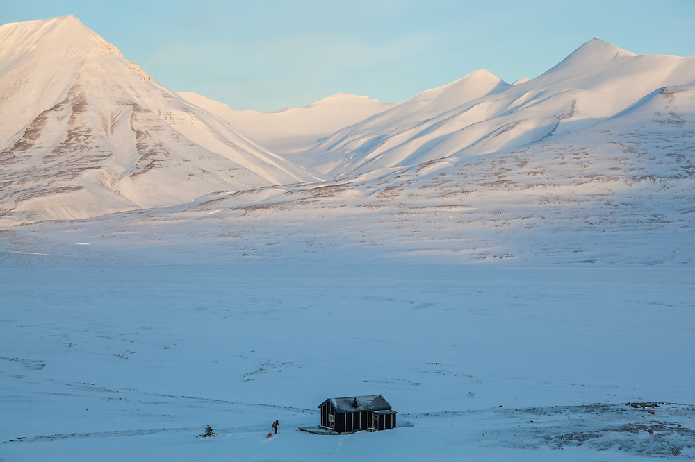 Mylène Jacquemart pulls a ski sled to a backcountry cabin at the mouth of Foxdalen in Adventdalen, Svalbard.