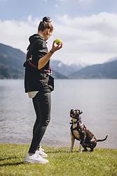 14.04.2020, Zell am See, AUT, Coronavirus in Österreich, im Bild eine Frau spielt mit ihrem Hund nach der Quarantäne während der Coronavirus Pandemie // a woman plays with her dog after the quarantine period during the World Wide Coronavirus Pandemic in Zell am See, Austria on 2020/04/14. EXPA Pictures © 2020, PhotoCredit: EXPA/ JFK