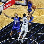 ORLANDO, FL - MARCH 01: Trey Burke #3 of the Dallas Mavericks attempts a shot over Evan Fournier #10 of the Orlando Magic during the second half at Amway Center on March 1, 2021 in Orlando, Florida. NOTE TO USER: User expressly acknowledges and agrees that, by downloading and or using this photograph, User is consenting to the terms and conditions of the Getty Images License Agreement. (Photo by Alex Menendez/Getty Images)*** Local Caption *** Trey Burke; Evan Fournier