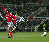 Photo. Andrew Unwin.<br /> Newcastle United v Charlton Athletic, FA Barclaycard Premier League, St James Park, Newcastle upon Tyne 20/03/2004.<br /> Newcastle's Laurent Robert (r) is brought down in the area by Charlton's Chris Perry (l).