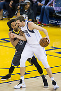 Golden State Warriors guard Shaun Livingston (34) holds off Dallas Mavericks forward Dirk Nowitzki (41) on the block at Oracle Arena in Oakland, California, on February 8, 2018. (Stan Olszewski/Special to S.F. Examiner)