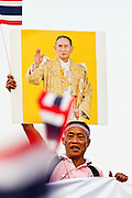 """Apr. 2, 2010 - BANGKOK, THAILAND: Supporters of the Thai monarchy at a peace demonstration in Bangkok, Friday. Thousands of """"Pink Shirts,"""" who claim to be neither """"Red Shirts"""" nor """"Yellow Shirts"""" nicknames for Thailand's dueling political forces, gathered in Lumpini Park in central Bangkok Friday evening to call for """"peace in the land,"""" a play on the Red Shirts slogan, """"Red in the Land."""" The """"Pink Shirts"""" represented educators, business people and people in the tourist industry, all of which have been hurt by the ongoing political protests that have disrupted life in the Thai capital. The """"Pink Shirts"""" stressed their loyalty to His Majesty Bhumibol Adulyadej, the King of Thailand, and chanted for the Red Shirts to """"Get Out!"""" of Bangkok.    PHOTO BY JACK KURTZ"""
