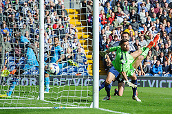 Emmanuel Adebayor (TOG) of Tottenham Hotspur scores a goal past Ben Foster (ENG) of West Brom to bring the score to 3-1, with a possible OG deflection from Jonas Olsson (SWE) of West Brom - Photo mandatory by-line: Rogan Thomson/JMP - 07966 386802 - 12/04/2014 - SPORT - FOOTBALL - The Hawthorns Stadium - West Bromwich Albion v Tottenham Hotspur - Barclays Premier League.