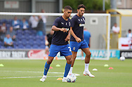 AFC Wimbledon defender Tennai Watson (2) warming up during the EFL Sky Bet League 1 match between AFC Wimbledon and Coventry City at the Cherry Red Records Stadium, Kingston, England on 11 August 2018.