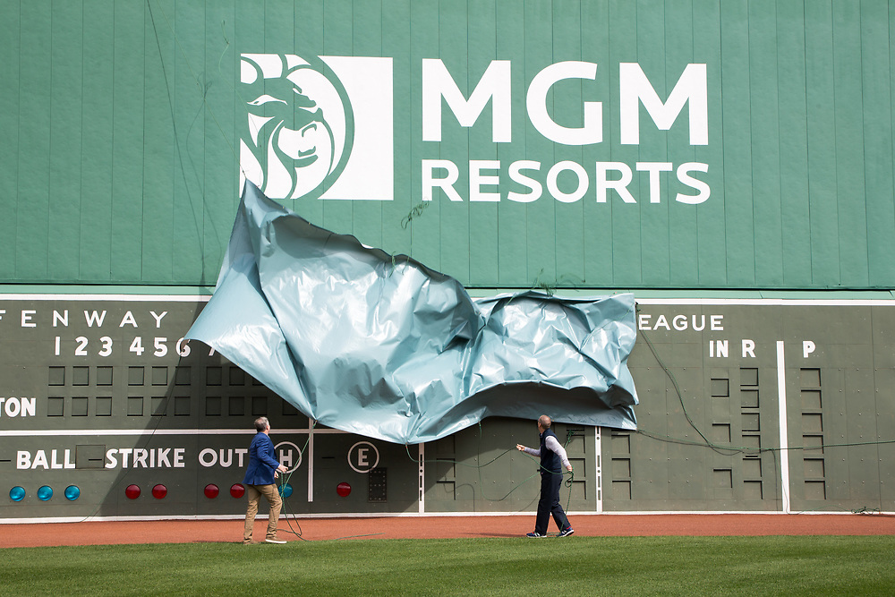 The MGM Resorts logo is revealed for the media on the Green Monster at Fenway Park.