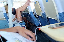 """Another Thai man's post about foreign woman's stinky feet on ferry headrest raises questions about behaviour...Kunakorn Jailbanjerd posted a photo on his Facebook page of a foreign woman resting her feet on the head of a chair while traveling on a ferry from Hua Hin to Pattaya...The farang woman, who is believed to be a Russian tourist, is featured in the post with her bare feet, casually draped on the headrest...""""People should be more respectful when they are visitors to other people's countries...In Thailand, feet are considered extremely dirty and should not be placed near other people or pointed at them..©Kunakorn Jailbanjerd/Exclusivepix Media (Credit Image: © Exclusivepix media via ZUMA Press)"""