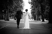 Bride & Groom walk up the Driveway of Beeston Fields Golf Club