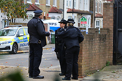 © Licensed to London News Pictures. 24/10/2020. London, UK. Police officers a at a crime scene on Westbury Road in Walthamstow, East London following the death of a 22 year old man. The victim was stabbed on Friday and was pronounced dead at the scene just before 10pm.  Photo credit: Dinendra Haria/LNP