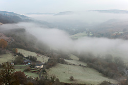 © Licensed to London News Pictures. 19/11/2019. Erwood, Powys, Wales, UK. The Wye Valley is shrouded in mist near Erwood in Powys, UK after temperatures dropped to several degrees C below zero last night and remained low during the morning near Builth Wells in Powys, UK. Photo credit: Graham M. Lawrence/LNP