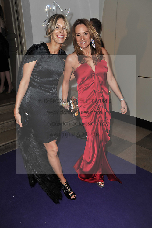 Left to right, KIM HERSOV and EMILY OPPENHEIMER-TURNER at The Surrealist Ball in aid of the NSPCC in association with Harpers Bazaar magazine held at the Banqueting House, Whitehall, London on 17th March 2011.