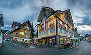 Hotel Appenzell and Gasthaus Hotel Hof (left) are good places to stay at Landsgemeindeplatz in Appenzell village, Switzerland, Europe. As Switzerland's most traditional canton, Appenzell Innerrhoden still publicly debates all elections and parliamentary business in the historic village square Landsgemeindeplatz, with citizens voting directly by a show of hands. In this rare form of government, every year on the last Sunday in April, around 3000 eligible voters gather in the Landsgemeinde, or open-air assembly. The region is so conservative that women were not allowed to vote until 1991. Among state governments worldwide, direct democracy by citizens (without intermediaries) now only exists in the Swiss cantons of Appenzell Innerrhoden and Glarus. Sadly, Landsgemeindeplatz is parking lot the rest of the year; whereas a special traffic-free park honoring their direct parlamentary system would be more aesthetic. Appenzell Innerrhoden is Switzerland's smallest-population canton, and second smallest by area. This image was stitched from multiple overlapping photos.
