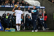 Kyle Naughton of Swansea city takes a throw-in as Paul Clement, the Swansea city manager (r) gives his instructions from the touchline. Premier league match, Swansea city v Southampton at the Liberty Stadium in Swansea, South Wales on Tuesday 31st January 2017.<br /> pic by  Andrew Orchard, Andrew Orchard sports photography.