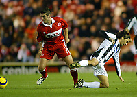 15/12/2004 - UEFA Cup, Group E - Middlesbrough v FK Partizan - The Riverside, Middlesbrough<br />Middlesbrough's Franck Queudrue out muscles FK Partizan Belgrade's Dragan Ciric<br />Photo:Jed Leicester/Back Page Images
