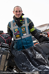 Alessandro Ciceri, better known as Wizz (@wizz_inwiaggio) on social media, is known for his cold weather riding exploits. He left his home in Italy and made the 6,200 mile (10,000 km) winter trip through Siberia just to race in the Baikal Mile. After the race, he had another 3,100 miles (5,000 Km) to get to Vladivostok where he will leave the bike for a few months. Here he is just after arriving at the Baikal Mile Ice Speed Festival. Maksimiha, Siberia, Russia. Thursday, February 27, 2020. Photography ©2020 Michael Lichter.