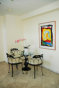 A painting of a sheep by Menashe Kadishman hangs on a wall in a home