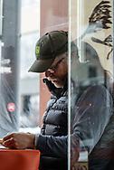 Man in restaurant window, Loveland CO