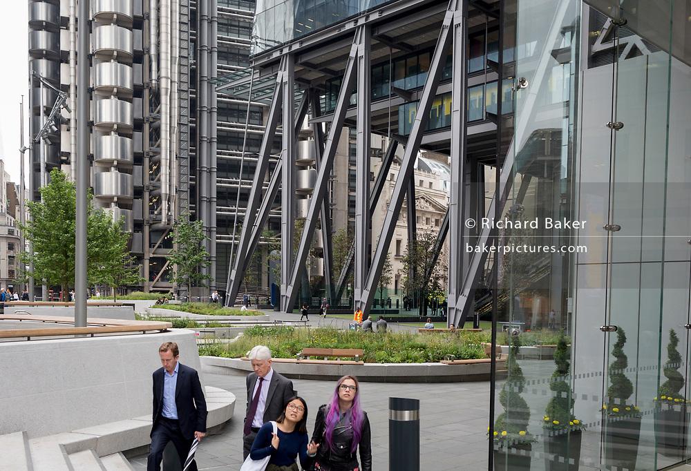 Business people outside Aviva Insurance on Leadenhall Street, on 30th May 2018, in London, England.