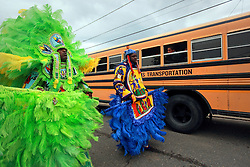 29 August 2014. Lower 9th Ward, New Orleans, Louisiana. <br /> Survivors of the storm. Mardi Gras Indians (L/R) Herbert Motton of the Hot Head Hunters and Robert 'Flag Boy Slim' Stevenson of the Hard Head Hunters lead a touching second line parade along Tennessee Street in the Lower 9th Ward in memory of those who perished in the storm 9 years ago. <br /> Photo; Charlie Varley/varleypix.com