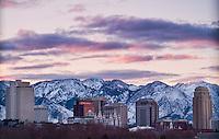 The Salt Lake City, Utah skyline in the early morning light of a Winter sunrise.