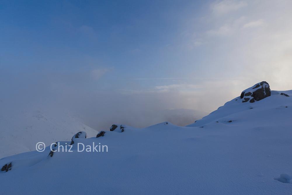 Fresh snow covering rocks on the NW ridge of Esk Pike (Glaramara in the background)