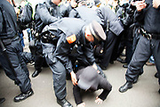 London, UK. Tuesday 11th June 2013. Protesters scuffle with police during a demonstration against the upcoming G8 summit in central London, UK.