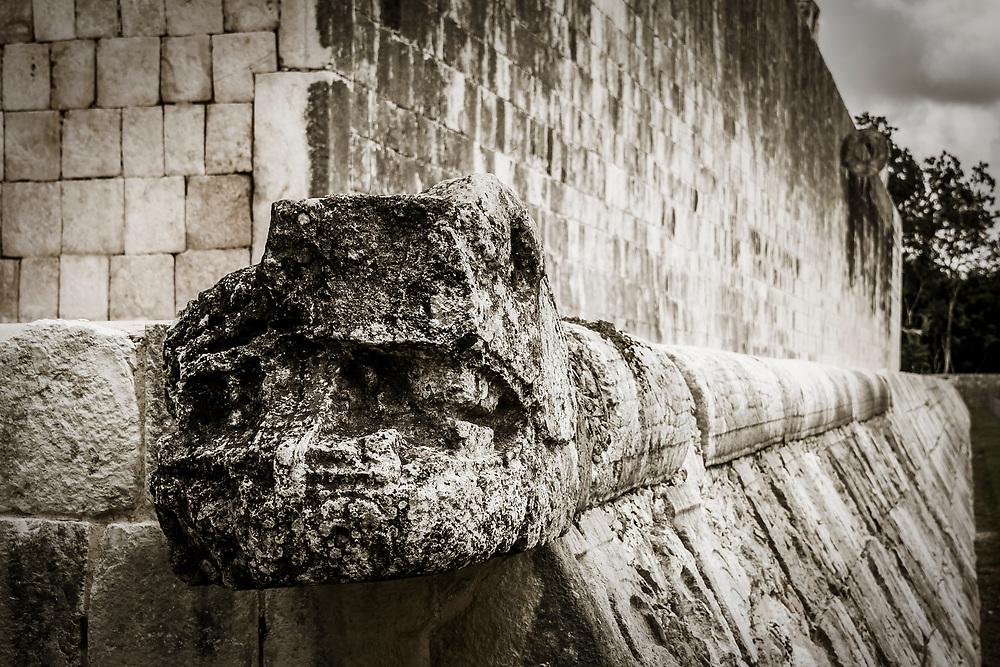 A feathered serpent god sculpture (Quetzalcoatl) at main Ball Court (Gran Juego de Pelota) at the Chichen Itza world heritage site, Yucatan, Mexico