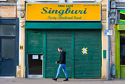 Closed for business,  a man walks past Thai Restaurant Singburi where on Tuesday, December 18, food safety officers uncovered dead mice festering in food preparation and storage areas at  the premises in High Road, Leytonstone. London, January 09 2019.