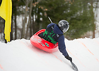 Eric Vasquez keeps his kayak in contro through the curve during the 3rd annual Boat Bash Snow Crash event at the Veteran's Memorial Ski Hill in Franklin Saturday afternoon.  (Karen Bobotas/for the Laconia Daily Sun)