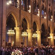 People pray at service inside Notre Dame de Paris, France