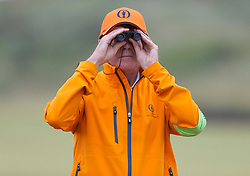 A marshal looks through his binoculars during day three of The Open Championship 2017 at Royal Birkdale Golf Club, Southport. PRESS ASSOCIATION Photo. Picture date: Saturday July 22, 2017. See PA story GOLF Open. Photo credit should read: Richard Sellers/PA Wire. RESTRICTIONS: Editorial use only. No commercial use. Still image use only. The Open Championship logo and clear link to The Open website (TheOpen.com) to be included on website publishing. Call +44 (0)1158 447447 for further information.