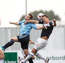 Dundee's Steven Doris and Falkirk's Will Vaulks.<br /> half time : Falkirk 1 v 0 Dundee, 21/9/2013.<br /> ©Michael Schofield.
