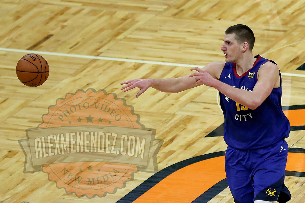 ORLANDO, FL - MARCH 23:  Nikola Jokic #15 of the Denver Nuggets passes the ball against the Orlando Magic at Amway Center on March 23, 2021 in Orlando, Florida. NOTE TO USER: User expressly acknowledges and agrees that, by downloading and or using this photograph, User is consenting to the terms and conditions of the Getty Images License Agreement. (Photo by Alex Menendez/Getty Images)*** Local Caption *** Nikola Jokic