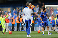 John Terry, the Chelsea captain lifts his son Georgie during a walk around the pitch after full time. Barclays Premier league match, Chelsea v Leicester city at Stamford Bridge in London on Sunday 15th May 2016.<br /> pic by John Patrick Fletcher, Andrew Orchard sports photography.