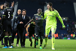 12th May 2017 - Premier League - West Bromwich Albion v Chelsea - Chelsea goalkeeper Thibaut Courtois celebrates with teammate Ngolo Kante (C) and Chelsea manager Antonio Conte (L) - Photo: Simon Stacpoole / Offside.