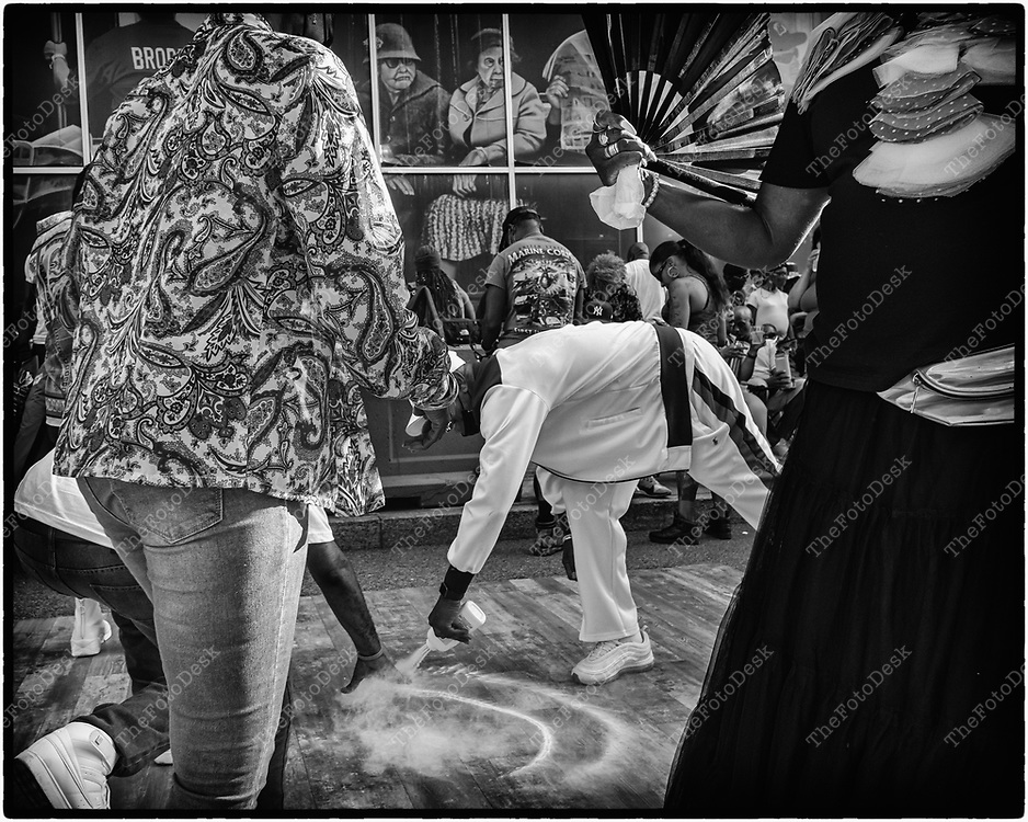 NEWARK, NEW JERSEY: A dancer spreads powder on the dance floor during the weekly Block Party on Edison Plaice in Newark, NJ on Friday, July 30, 202. (Brian B Price/TheFotodesk).