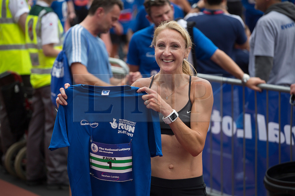© licensed to London News Pictures. London, UK 21/07/2013. Paula Radcliffe attending The National Lottery Anniversary Run at Queen Elizabeth Olympic Park on Sunday, 21 July 2013 to support 12,500 runners. The Stadium at Queen Elizabeth Olympic Park open its doors to the public for the first time since London 2012. Photo credit: Tolga Akmen/LNP