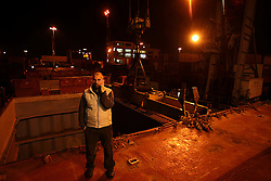 Captain Naoum El Hajj, of Lebanon, stands on the deck of the Bisanzio to make sure an approaching ship does not get too close to his vessel in Port Said, Egypt on April 9, 2008. The Bisanzio, a feeder ship taking containers from Port Said to Beirut, is Lebanese owned but flies a St. Vincent flag. The Suez Canal is one of the most important shipping routes in the world, as it allows allows two-way water transportation - most importantly between Europe and Asia without the circumnavigation of Africa.