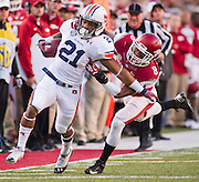 Auburn running back Tre Mason (21) is brought down by Arkansas cornerback Tevin Mitchel (8) pursues during an NCAA college football game in Fayetteville, Ark., Saturday, Nov. 2, 2013. Auburn defeated Arkansas 35-17. (AP Photo/Beth Hall)