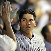 Jacoby Ellsbury,  New York Yankees, congratulated by team mates in the dugout after Jacoby Ellsbury hit a two run home run during the New York Yankees Vs Cincinnati Reds baseball game at Yankee Stadium, The Bronx, New York. 18th July 2014. Photo Tim Clayton