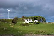 Whitewashed cottage powered by wind turbine near Harlosh on the Isle of Skye, Western Isles of Scotland, UK