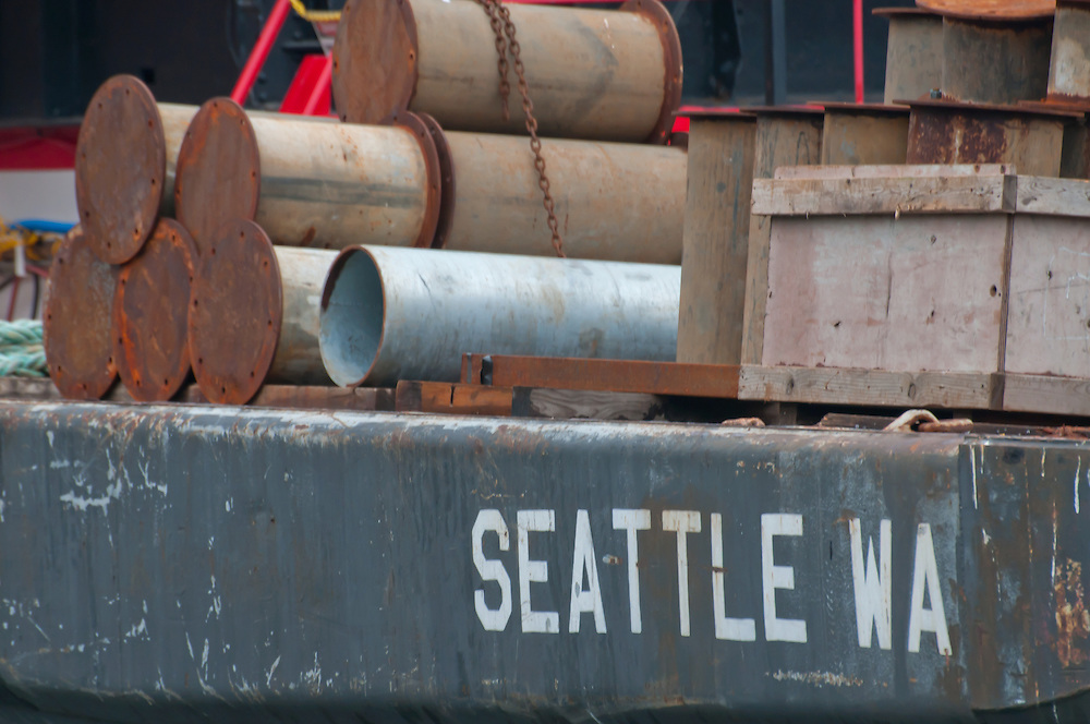 A barge on the Seattle Waterfront, Seattle, Washington.  Photo by William Byrne Drumm.