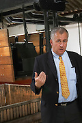 Jean Herve Chiquet in the winery in front of a traditional square vertical champagne wine basket press, Champagne Jacquesson in Dizy, Vallee de la Marne, Champagne, Marne, Ardennes, France, low light grainy grain