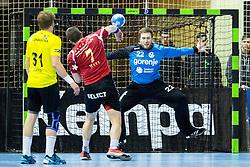 Marcel Hess of Winterthur vs Klemen Ferlin of RK Gorenje during handball match between RK Gorenje Velenje (SLO) and Pfadi Winterthur (SUI) in Group Phase of EHF European Cup 2014/15, on March 8, 2015 in Rdeca dvorana, Velenje, Slovenia. Photo by Vid Ponikvar / Sportida