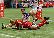 VANCOUVER, BC - MARCH 10: John Moonlight (#4) of Canada scores despite Ben Pinkelman (#2) of USA  during Game # 16- Usa vs Canada Pool A match at the Canada Sevens held March 10-11, 2018 in BC Place Stadium in Vancouver, BC. (Photo by Allan Hamilton/Icon Sportswire)