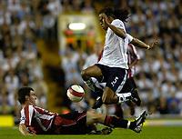 Photo: Daniel Hambury.<br />Tottenham Hotspur v Sheffield United. The Barclays Premiership. 22/08/2006.<br />Tottenham's Edgar Davids and Sheffield's Chris Morgan battle.