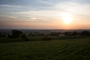 View at sunset over farmland at Kilburn in The Hambleton Hills on the edge of the North York Moors looking towards the Vale of York. Yorkshire, England, UK. This is a farming area where rural living and the countryside is at the centre of life in this county.